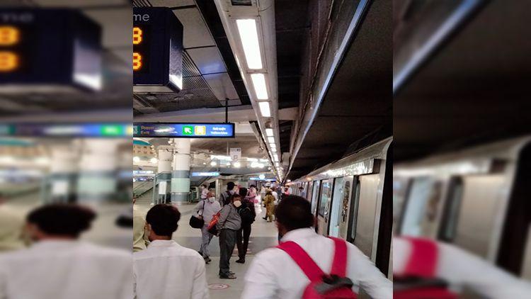 The Mandi House Metro Station & few passengers on its platform