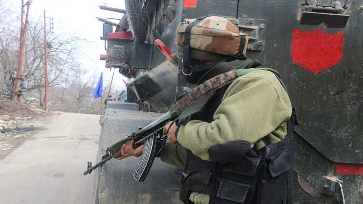 Security forces stand guard near encounter site at Rawalpora Shopian