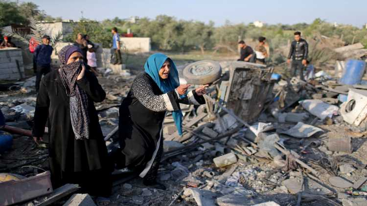 Images from Gaza: women looking through the rubble of houses destroyed