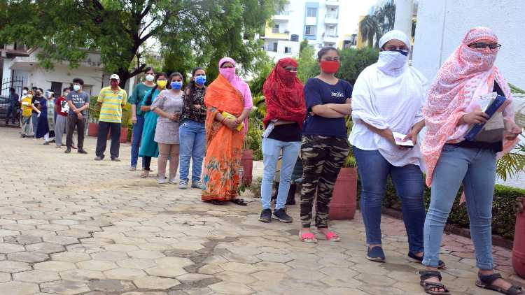 People in a queue to receive COVID19 vaccine in Bhopal