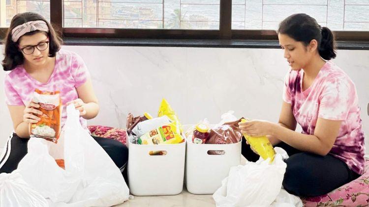 Dania Khan and Ridha Khan making ration kits