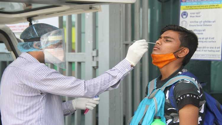 Health worker collect swab sample for Covid-19 testing