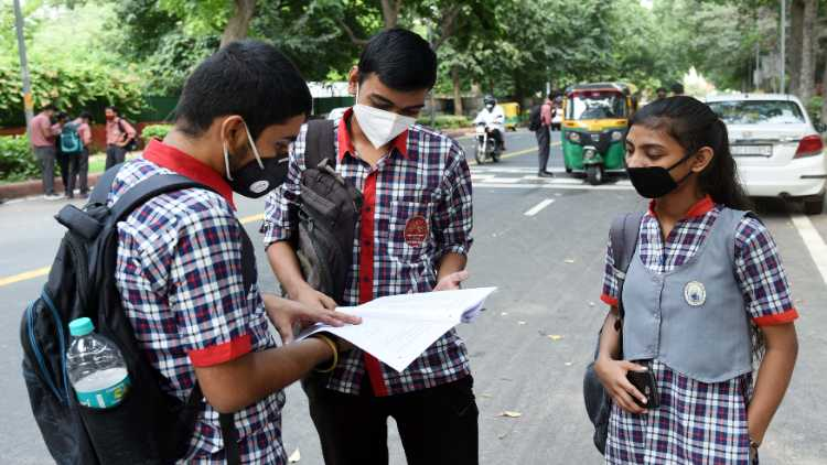 Students revising outside a school during the CBSE compartment examination, in New Delhi on Sep. 22 last year