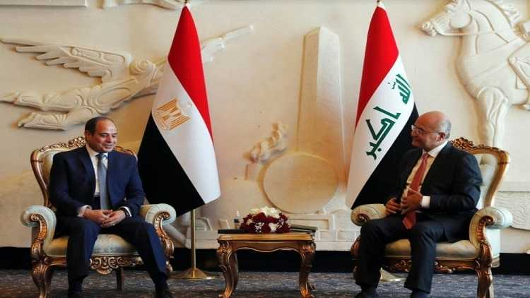 Iraqi President Barham Salih (R) meets with Egyptian President Abdel-Fattah al-Sisi in Baghdad