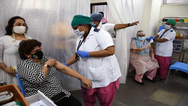 A senior citizen getting vaccinated in Delhi