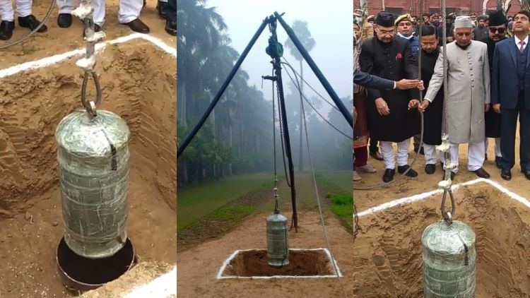 AMU's history capsule being lowered in pit