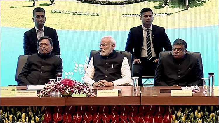 PM Modi with Chief Justice of India SA Bobde and Union Minister Ravi Shankar Prasad at the International Judicial Conference, in New Delhi on Feb. 22