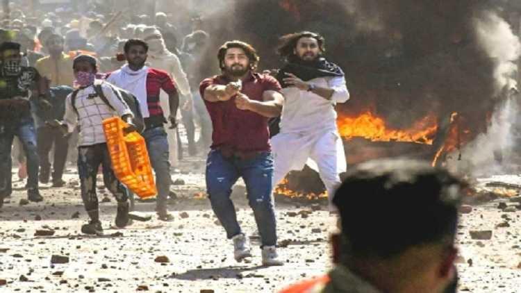 A protestor against the Citizenship Amendment Act (CAA) wields a pistol in northeast Delhi in Feb.2020