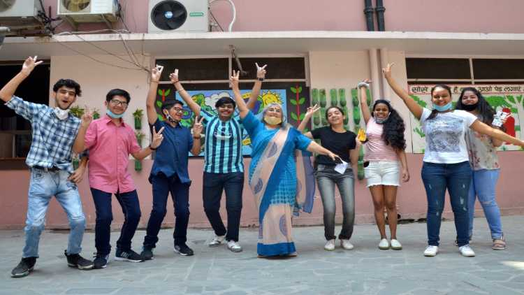Students celebrate after the CBSE declared their exam results