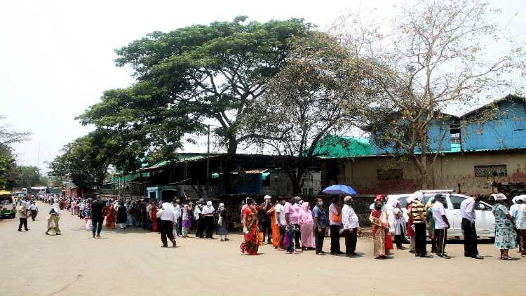 People outside inoculation center in Mumbai